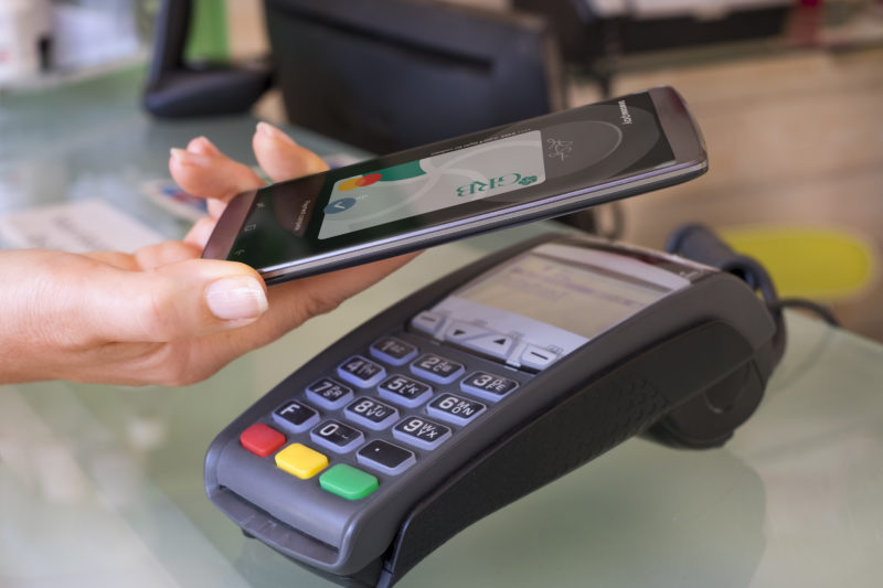 Photo showing use of mobile device as a Digital Wallet