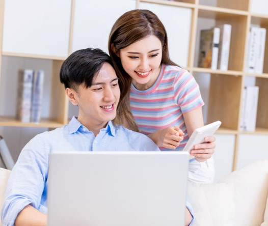 Couple working together to set up online bank account