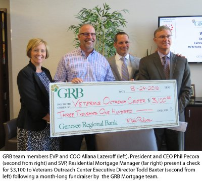GRB's Executive team presents $3,100 to the VOC's Todd Baxter