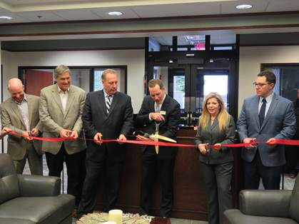 Photo of guests cutting the ribbon in Greece Branch