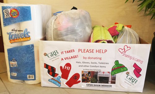 Collection box with donations for the Open Door Mission