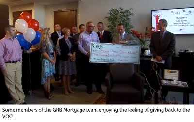 Photo of GRB employees participating in the ceremony presenting the check to the Veterans Outreach Center.