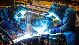 Photo of welders with sparks flying